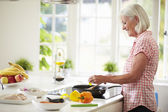 Woman Cooking Meal In Kitchen — Stock Photo