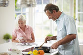 Couple Cooking Meal In Kitchen Together — Stock Photo