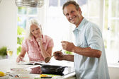 Couple Cooking Meal In Kitchen Together — Foto Stock