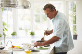 Man Following Recipe On Digital Tablet — Foto Stock