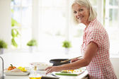 Woman Following Recipe On Digital Tablet — Foto Stock