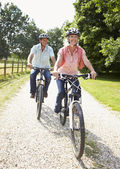 Couple Enjoying Country Cycle Ride Together — Stock Photo