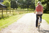 Woman Enjoying Country Cycle Ride — Stock Photo
