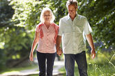 Couple Walking Along Countryside Path — Stock Photo