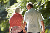 Couple Walking Along Country Lane — Stock Photo
