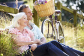 Woman Relaxing On Country Cycle Ride — Stockfoto