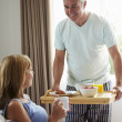 Husband Bringing Wife Breakfast — Stock Photo #48300291