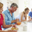 Family Having Breakfast In Kitchen — Stock Photo #48300759