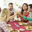 Friends Sitting Around Table Having Dinner — Stock Photo #48301331