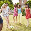 Friends Playing Football In Garden — Stock Photo #48301677