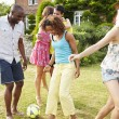 Friends Playing Football In Garden — Stock Photo #48301683
