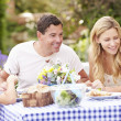 Family Enjoying Outdoor Meal — Stock Photo #48302339