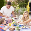 Family Enjoying Outdoor Meal — Stock Photo #48302343