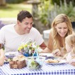 Family Enjoying Outdoor Meal — Stock Photo #48302351