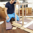 Man Putting Together Assembly Furniture — Stock Photo #48304889