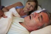 Man Keeping Woman Awake — Stock Photo