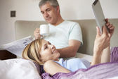 Couple Relaxing In Bed — Stock Photo