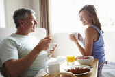 Wife Bringing Husband Breakfast — Stock Photo