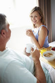 Wife Bringing Husband Breakfast — Foto de Stock