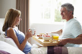 Husband Bringing Wife Breakfast — Stock Photo