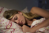 Girl Asleep In Bed At Night — Stock Photo