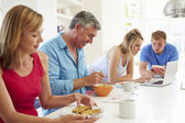 Family Having Breakfast In Kitchen — Stock Photo