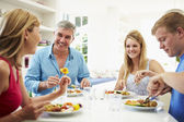 Family With Teenage Children Eating Meal — Stock Photo