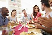 Friends Sitting Around Table Having Dinner — Stock Photo