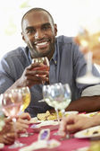 Man Relaxing At Dinner Party — Stock Photo