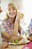 Woman Relaxing At Dinner Party — Stockfoto