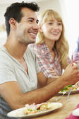 Couple Relaxing At Dinner Party — Stock Photo