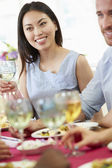 Couple Relaxing At Dinner Party — Stockfoto