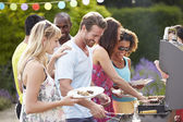 Friends Having Outdoor Barbecue — Stock Photo