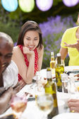 Woman Relaxing At Outdoor Barbeque — Stock Photo