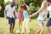 Friends Playing Football In Garden — Stock Photo