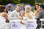 Bride And Groom With Bridesmaid At Wedding Reception — Stock Photo