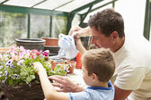 Father And Son Watering Plants — Stock Photo