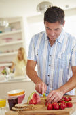 Man Preparing Healthy Breakfast — Stock Photo