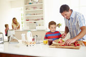 Son Helping Father To Prepare Family Breakfast — Stock Photo