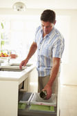 Man Recycling Kitchen — Stock Photo