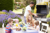 Family Enjoying Outdoor Barbecue — Foto de Stock