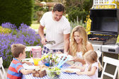 Family Enjoying Outdoor Barbecue — Stock Photo