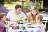 Family Enjoying Outdoor Meal — Stock Photo