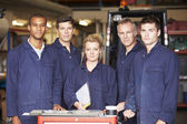 Staff Standing In Engineering Factory — Stock Photo