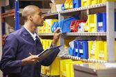 Worker Checking Stock Levels — Stock Photo