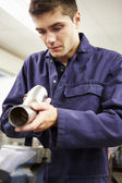 Apprentice Engineer Checking Component — Stock Photo