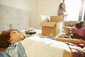Two Women With Boxes In Bedroom — Stock Photo