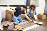 Couple Putting Together Assembly Furniture — Stock Photo