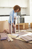 Woman Putting Together Self Assembly Furniture — Stock Photo