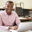 Male Architect Working At Desk On Laptop — Stock Photo #48459165